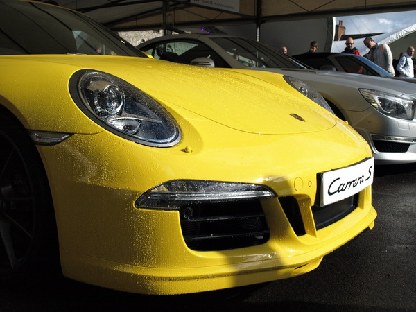Morning rain on the racing yellow Carrera S. #porschegoodwood #fosgoodwood