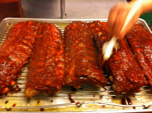 JJ brushing the chipotle glaze on ribs for tonight&#039;s Frontera special