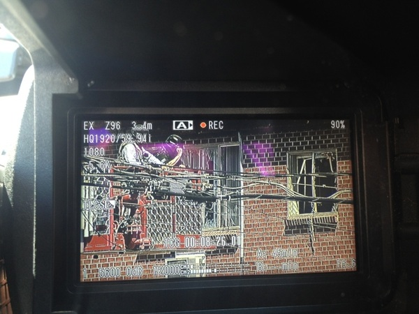 [PIC] close up view of police at suspect's apt window.  Through viewfinder.  #theatershooting