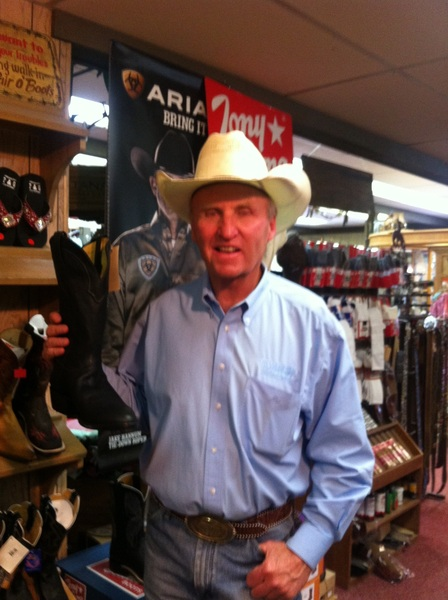 I'm buying boots in the Cowboy Shop, Pinedale, WY from Bobby Bing whom I've known all my life.