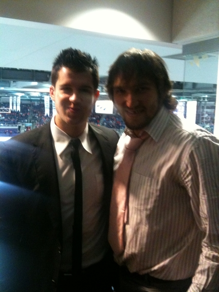 Me and Ovie at the game tonight wishing we were out there playing with the boys... Let go caps