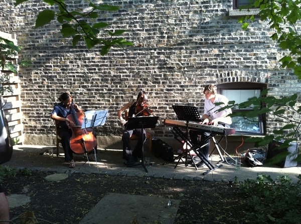 Etherial trio warming up under the trees