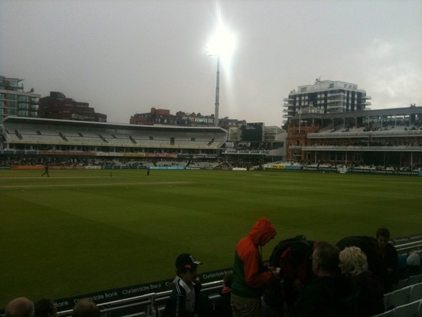 Rain interrupts us. Floodlights on.