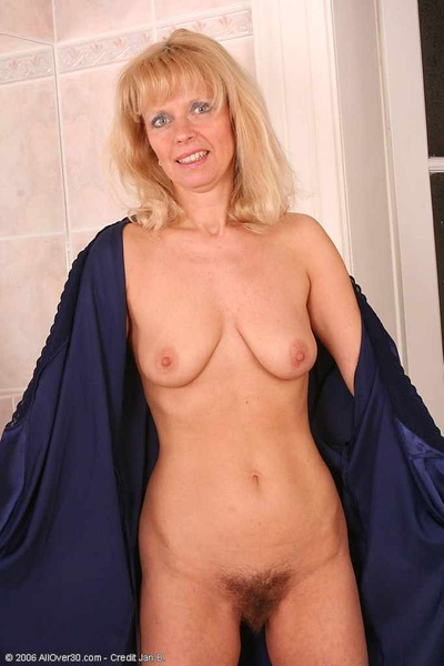 #mature woman shows her stunning #titties and #hairy #pussy.