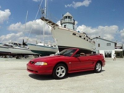 We have a great red Mustang GT on the lot! And it's a convertible. Http://Charlottemotorcars.com
