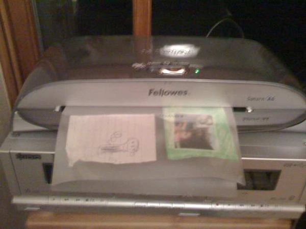 Laminator in action - preserving important works.