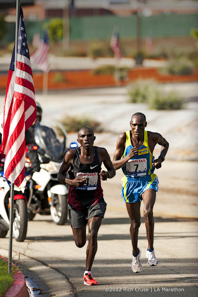Race winner Simon Njoroge (L) and 2nd Plc Weldon Kirui (R) run thru the Veterans Administration @lamarathon .