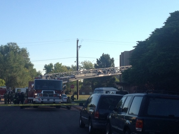 [PIC] on the ground near suspect's apt.   Fire truck ladder leads to building.