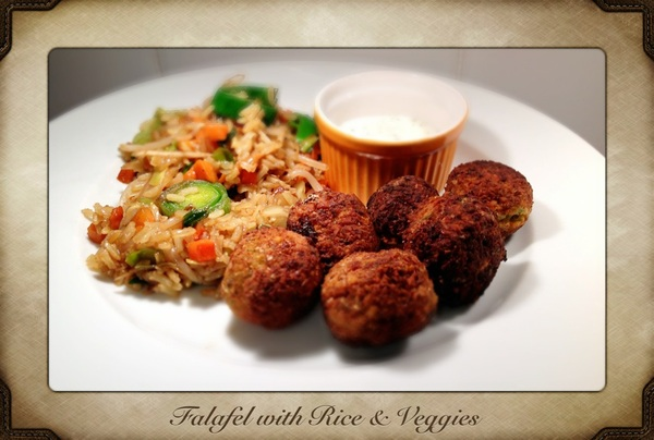 The end result of today&#039;s cooking.. Falafel with rice and vegetables!