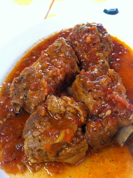 Carmelita&#039;s: pork ribs braised w heirloom tomatoes, serrano, garlic, herbs. Unbelievable tomato flavor!